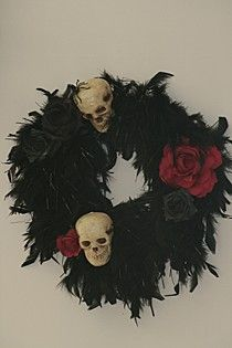 Wreath of Skulls Roses and Feathers    I made this wreath using a Black Feather Boa. I attached Skulls n Roses, which I spray Black and added and little glitter to the Centre. Another winner in my Halloween Room in Oz. All my friends want me to make them one :)