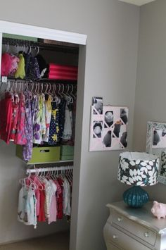 Toddler Girl Room organized closet. Love the idea for lower hangers. Easier for her to reach.