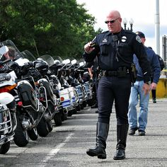 Austin PD motorcop taking pics of the line of cop motorcycles already lined up in the RFK parking lot an hour and a half before the start-off of the 2010 Law Ride. Sexy Military Men, Hot Cops, Police Uniforms, Criminal Defense, Bald Men, Men In Uniform, Motorcycle Boots, Gay Pride, Firefighter