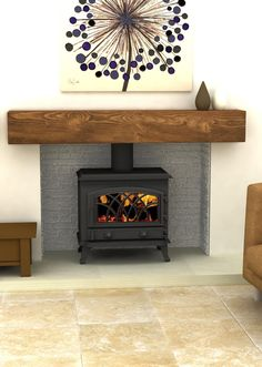 Really like this inset wood burning stove. A modern take on the vintage classic.
