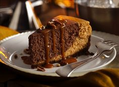 Chocolate Bourbon Pumpkin Cheesecake | This cheesecake is exploding with flavor. A gingersnap crust is the base while the cheesecake batter is flavored with pureed pumpkin, warm winter spices like ginger and cinnamon, and a secret ingredient - aromatic bitters.  The bitters adds a dimension of flavor that comes from no other ingredients.