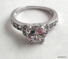 sz.6&7 Exquisite Austrian Crystal, Rhodium Plated Ring. Starting at $5 on Tophatter.com!