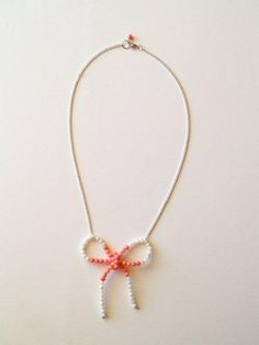 Knock-off anthro bow necklace. So dainty and pretty! Would look great with a solid shirt and cardigan.