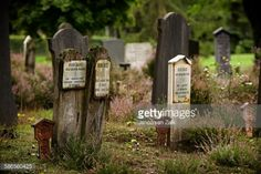 Some old wooden gravestones with enameled signs on them, on a... #elspeet: Some old wooden gravestones with enameled signs on… #elspeet
