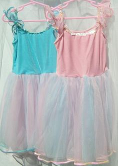 Princess Dresses from My Princess Party to Go. Soft Stretch Velour Top. Full Multi Layer Pastel Tulle Skirt. Sparkle Sequin Trim at Neckline, Waist and Hem. Flutter Sleeves have Sequin Trim. #princessparty #dresses #princessparty