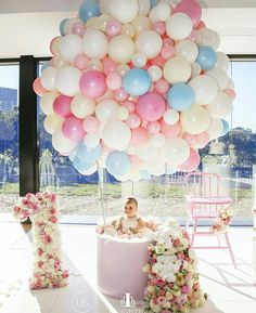 I wonder if we could make this work like a chandelier- hanging them upside down, without helium??