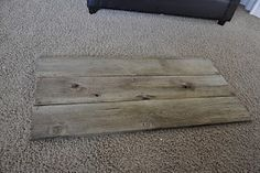 Idea in process:  Find barnwood, wash with a red thinned paint, sand down to faux weather, place a large black monogram and Est. 2000 on bottom corner.  We need about a 6x6 foot square.