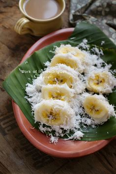 Pisang Rai~ Coconut Banana (Pisang Rai) is one of traditional Balinese heritage snack, it is made from banana which usually be eaten as a breakfast (a traditional breakfast) along with tea/coffee, on the other hand, its also perfect snack for your afternoon tea/coffee. The bananas are first coated in a homemade batter of rice flour, boiled/steamed and then toppled over with fresh grated coconut. (Ira Rodriguez)