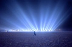 A man walks on the frozen Songhua river beside the Harbin international ice and snow festival