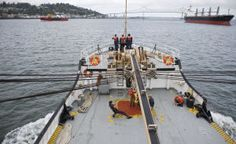 The Tongue Point Job Corps buoy tender Ironwood navigates downstream toward the Columbia River bar in Astoria.