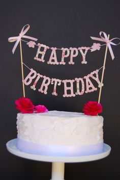 Pretty birthday cake bunting-- maybe print letters on some Cath Kidston-ish paper?