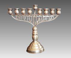 A Silver Hanukiah - Hanukkah 9 Branch Menorah for the celebration of the Hanukkah Holiday. Made by Achsaf Silversmiths in Sterling Silver with