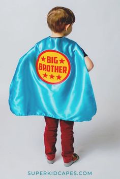 Need an gift idea for a new big brother or big brother to be? Our turquoise blue big brother superhero cape ships next day and is the perfect gift to bring to the hospital to surprise your new big brother. Our big brother capes are perfect for big brother gift baskets, gifts for the hospital visit, gender reveal announcements and cute birth announcements! The cape is turquoise on the outside with a red and yellow design. Visit us at superkidcapes.com! Superhero Capes For Kids, Superhero Dress Up, Superhero Party, New Big Brother, Gifts For Brother, Birthday Gifts For Boys, Unique Birthday Gifts, New Sibling Gifts, Gender Reveal Announcement