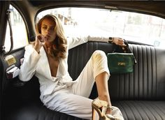 white suit green bag