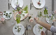 A summer table setting with fresh flowers.