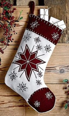 """Purchase one of our North Star Felt Stocking 11x15"""" or several for your fireplace, shelf, or even and old painted chippy ladder. They are so festive and fun with the embroidered snowflakes. https://www.primitivestarquiltshop.com/products/north-star-felt-stocking-11x15 #MerryChristmas"""