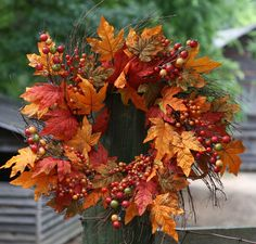 Beautiful 24 Inch Weather Resistant Wreath that can be used Indoors or Outdoors - Full Wreath with a Mixture of Berries and Leaves in all the Great Fall Colors, Browns, Reds, Greens, Orange and Yellow