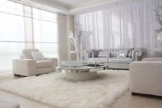 Spectacular Round Glass Levels Coffee Desk Storage On White Rectangle Fur Rug Also White Chesterfield Living Tufted Couch As Decorate White Living Room Ideas