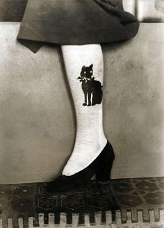 Stockings with Black cat on them, circa 1914.