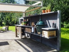 WWOO outdoor kitchen anthracite with the WWOO canopy | www.wwoo.nl