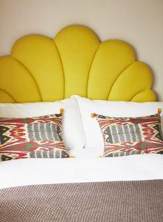 Yellow headboard, bedroom, ikat cushions, t.craig interiors