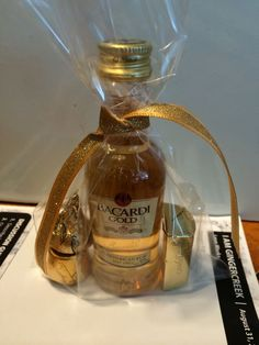 Mini Bacardi Bottles, mini Hershey's Gold Nugget & Kisses & Rolo & a Gold Ribbon to finish it off! 60th Birthday Theme, Golden Birthday Parties, Birthday Party Favors, Golden Anniversary Gifts, Anniversary Ideas, Candy Bar Wrappers, Bacardi, Mini Bottles, Event Planning
