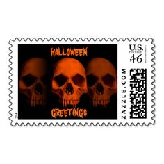 Halloween horror fanged skulls in black and orange postage stamp