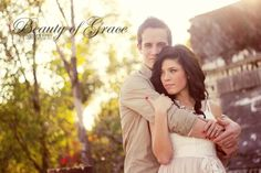 By Jessica Cash  facebook.com/beautyofgracephotography  Engagment session couple photo embrace sunflare backlit backlighting