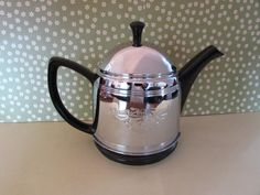Excited to share the latest addition to my #etsy shop: Vintage Black Ceramic Teapot with Ornate Silver Insulated Cosy 4 Cup http://etsy.me/2E8F2Mn #housewares #black #cosy #mothersday #silver #vintage #teapot #4cup #ceramic#valentinesday#birthday