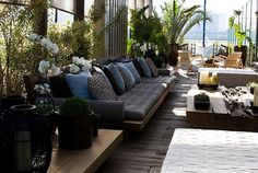 Outdoor entertaining area with low lounges and plants surrounding you. LOVE the deck!