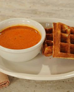 Two types of cheeses and rich buttermilk add a tangy and sweet flavor kick to basic waffles in this recipe from Linton Hopkins of Restaurant Eugene in Atlanta. Serve them with his homemade Tomato Soup.