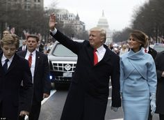 Donald and Melania Trump were joined by their 10-year-old son Barron to wave to crowds on Pennsylvania Avenue on Thursday during the Inaugural Parade.