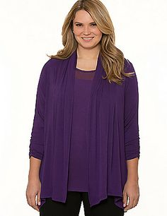 Essential 3/4 sleeve overpiece lets you layer effortlessly year round with a lightweight knit that's always comfortable. This ultra-versatile style puts the finishing touch on casual and dressy outfits with a draped open placket to frame what's underneath. Ruched sleeves and neck detail lends a feminine finish. lanebryant.com