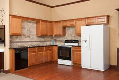 Below is a list of cabinets included in our layout. List of cabinets included in 10 x 10 pricing! We are here to help you get your dream kitchen, we have a limitless selection of colors. Solid Wood Kitchen Cabinets, Solid Wood Kitchens, Kitchen Cabinet Drawers, Brown Kitchens, Ready To Assemble Cabinets, Kitchen Cost, Kitchen Design Gallery, Rta Cabinets, Kitchen Pictures