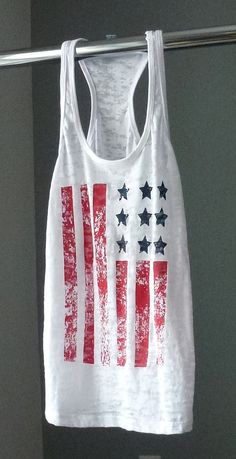 Simple. Classy. Versatile. American.  This American Flag distressed design is so hot you can pair it with a your maxi skirt or boyfriend jeans and sexy ankle boots or throw it on over your bathing suit with flip flops and shorts for a 4th of July party.  Wear it any time of the year simply because you are proud to be an American! by RainDancerClothing