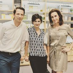 Bertrand (left), Caudalie co-founder and husband of Mathilde Thomas, the book's author in a Juliette Longuet dress (right), with another French beauty, Audrey Tautou (center), at the their boutique at the Louvre, in Paris.