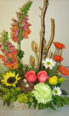 Flowers growing upward.... seeking the sun -Designed by The Tuscan Sunflower, Bennington, VT