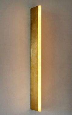 pinned by barefootstyling.com Tube Wall Light by Michael Anastassiades | See more at http://www.brabbu.com/en/inspiration.php