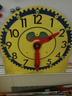 Oh my gosh. This clock! We each had our own in like second or third grade and we have races to see who could get the correct time the fastest.    My teacher would be dissappointed to know that I have difficultly reading clocks now...it just takes too long!