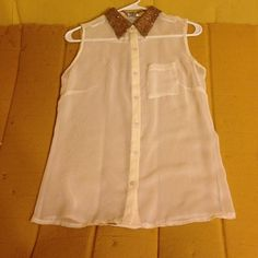 White see-through sequin shirt Button down cream colored shirt with a sequin collar. Only worn once. Too small for me buts it's really cute Tops Tank Tops