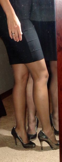 My wife and I wearing the same heels and hose, and similar skirts.