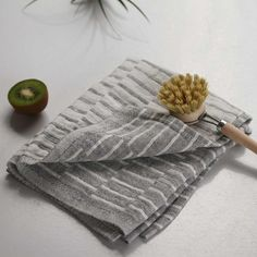 "A beautiful big and thick linen dish towel. Very soft heavy, pre-washed linen woven in a classic grey and white staggered lines pattern. With the reverse on the back, and with selveged edges. Ultra absorbent, these towels become even softer and better the more you use them. They also work beautifully as napkins.  48 x 70 cm or approximately 27.5"" x 19""  100% linen. Made in Finland."