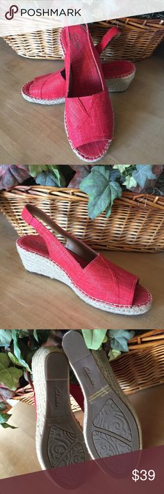 """NEW Clarks Red Petrina Rhea Espadrille Sandals Clarks Petrina Rhea Espadrille Wedge Sandal  Brand new without box  Size 9.5  A rope-covered wedge and subtle sparkly, canvas upper lend versatile style to a peep-toe espadrille with an elastic gore at the tongue for comfort.  * 2 1/2"""" heel (size 9.5)  * Slingback strap with elastic band.  * OrthoLite(R) insole.  * Textile upper and lining/rubber sole.  * By Clarks(R)    Lightweight and super comfortable!! Clarks Shoes Wedges"""