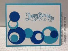 handmade birthday card ... blue punched circles ... lik the asymetrical designs ... Stampin' Up!