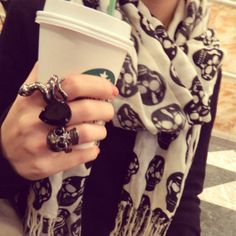 Skull scarf(which I will be purchasing because I found the perfect one!) amazing rings, and Starbucks. This is so me!