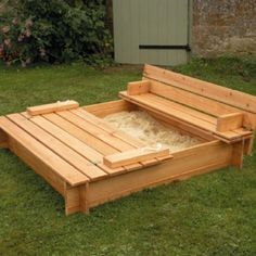 would love for my hubby to build a sandbox like this for Abigail, so cute and would keep animals out.