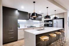 SH Design// The striking kitchen in our 'My Sanctuary' display home at Springtime Estate, Haynes open Sat & Sun Black Kitchens, Home Kitchens, Kitchen Black, Modern Kitchens, Custom Home Builders, Custom Homes, Chalet Canada, Kitchen Layout, Kitchen Ideas