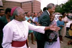 Archbishop Desmond Tutu leads Mandela through the neighborhood in Soweto where Mandela lived before going to prison — the same neighborhood home to Archbishop Tutu — on the first day of his release from prison. Photo by David Turnley