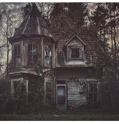 At the bottom of a shadowy lane, the little house still stands, although, long since abandoned.