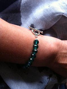 Armband met groene Swarovski kralen en zilveren sluiting
